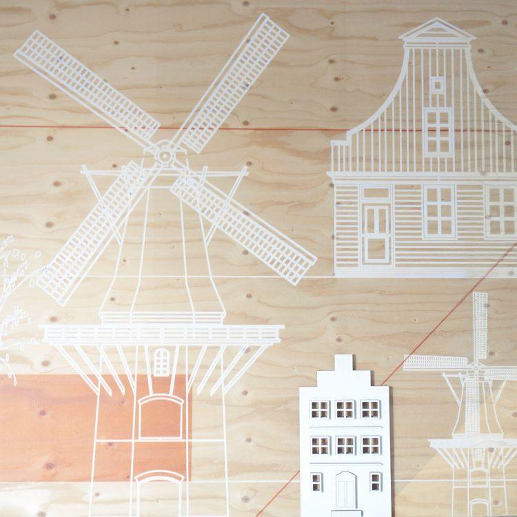 Wandlamp in de vorm van een Hollands huisje (grachtenpand) met trapgevel. De lamp is beschikbaar in verschillende kleuren strijkijzersnoer.